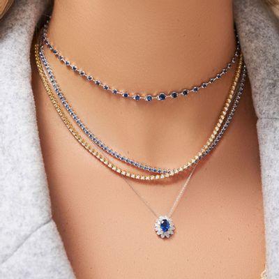 Colar-pendente-de-ouro-com-safira-e-diamantes-